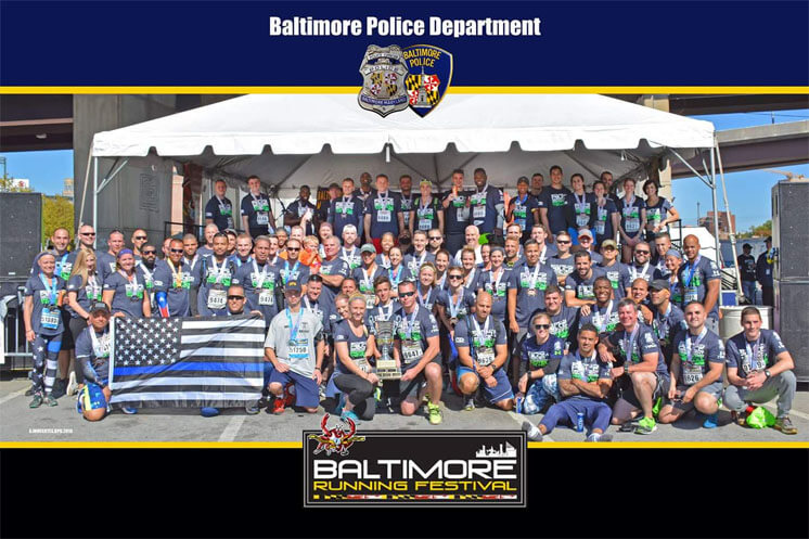 group of police officers pose for baltimore running festival