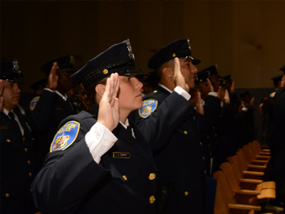 officers holding hands for oaths